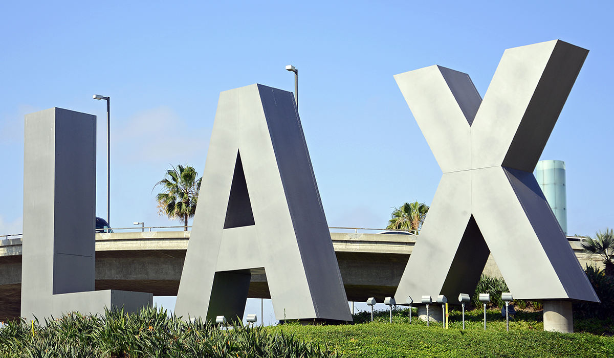 LAX signage at night with neon colored lights